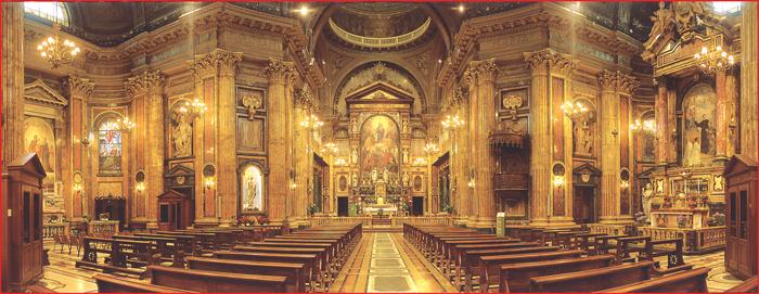 A imagem do interior da Basílica de Maria Auxiliadora, em Turim (Itália), onde foi colocado o quadro de Maria, Mãe da Igreja. Este Santuário foi erigido por São João Bosco como monumento de reconhecimento à Virgem Maria, com o título AUXILIADORA.